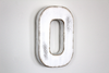 "White ""wooden"" letter O in a distressed and rusty finish"