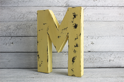 """Wooden"" yellow letter M freestanding"
