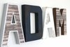 Woodland nursery letters spelling out Adam in silver, navy, white, and brown.