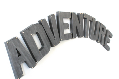 Silver Adventure playroom wall sign with silver studs in the corners.