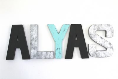 Boho Modern monochrome wall letters for a monochrome nursery in black, silver, and teal letters spelling out the name Alyas.