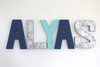 "Blue gender neutral wall letters in navy blue, teal, and silver ""metal"" letters spelling out the name ALYAS."
