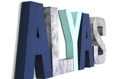 Modern nursery gender neutral wall letters in two different shades of blue and silver.