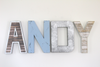 Custom wall letters spelling out Andy in silver, brown, blue, and white colors.
