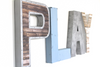 "Kid's playroom PLAY sign in ""wood"" and ""metal"" blue and silver letters."