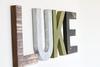 Woodland nursery letters spelling out Luke.