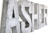 Industrial silver letters with a nail trim design going around the letter spelling out the name ASHER.