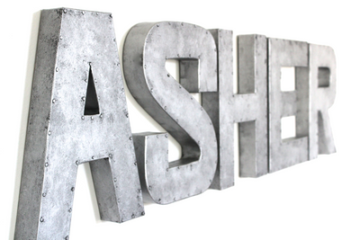 Asher custom wall letters in a galvanized letter style.