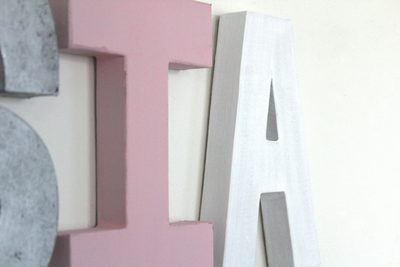Pink letter I and a white letter A for girls nursery wall decor.