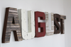 Fireman nursery name letters spelling out August in different shades of brown, white, and red.