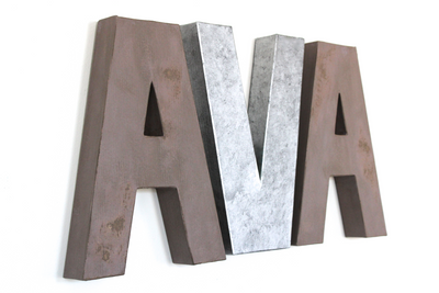 """Wooden"" and ""Industrial"" nursery wall letters spelling out AVA."