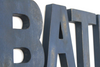 """Wooden"" navy letters spelling BATH for bathroom decor."