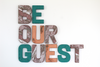 Be our guest wooden wall letters in different colors.