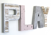 Coastal nursery play sign in whites, pink, and silver.