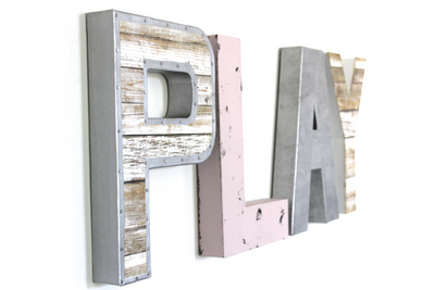 Girls playroom wall play sign in pink and silver.