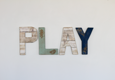 Play sign for coastal nursery decor.