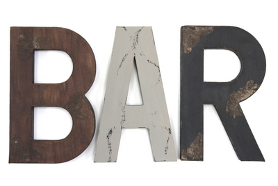 "Large Bar ""wooden"" wall letters in brown, grey, and black and a brown arrow.."