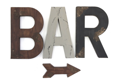 Large bar wall letters spelling out the word BAR in brown, grey, and black.