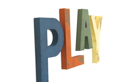Large colorful PLAY letters in blue, orange, green, and yellow for playroom wall decor.
