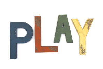 Colorful wall letters for playroom wall decor in blue, orange, green, and yellow.