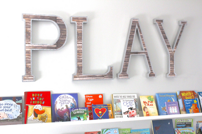 "Large ""wooden"" and ""metal"" play letter sign for playroom wall decor."