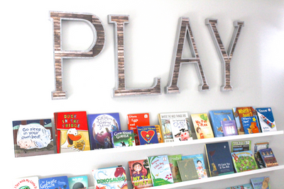 Large play letters for playroom wall decor.