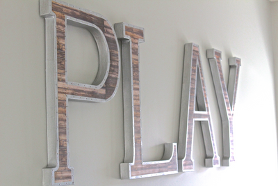 "Large ""wooden"" and ""metal"" play letters for kids playroom wall decor."