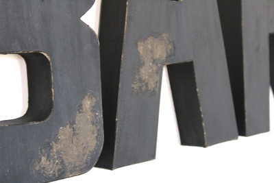 "Distressed ""wooden"" black letters."