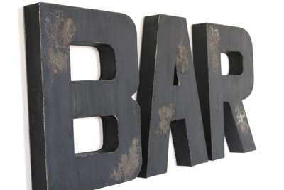 "Distressed black ""wooden"" bar wall letters."