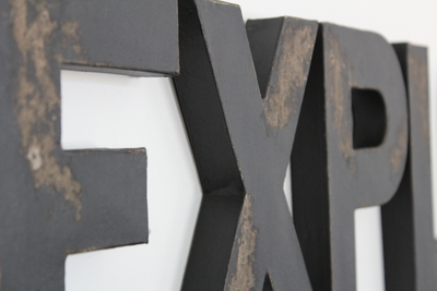 Explore sign in black distressed.
