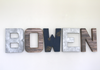 Bowen nursery letters for rustic industrial nursery decor in silver, brown, and navy colors.