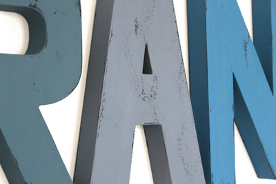 Different shades of blue letters for nursery wall decor.