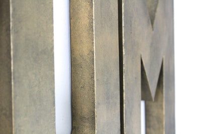 Brass YUM wall letters for kitchen wall decor.