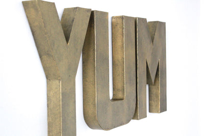 "Brass ""metal"" YUM wall sign letters."