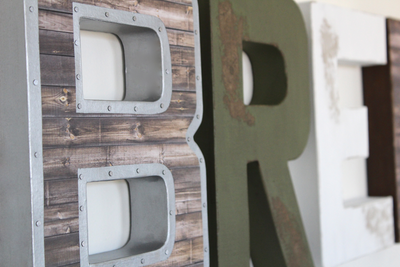 Nursery wall letters in brown, green, and white colors for adventure themed nursery wall decor.