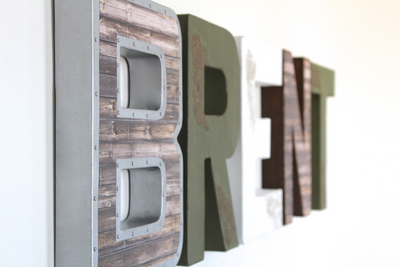 Brent nursery name letters in brown, white, and green.