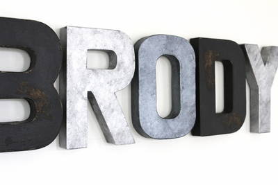 "Boy name wall letters in a rustic black, silver, and grey ""metal"" letters."