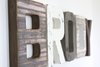 Rustic boys room name letters spelling out the name Brody in wood tones, gray, and white.