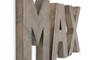 Faux metal bronze wall letters spelling out the name MAX for industrial nursery wall decor.