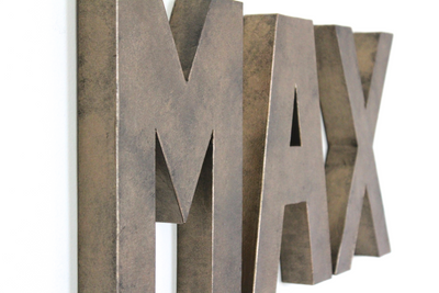 Bronze letters spelling out Max for tween room decor.