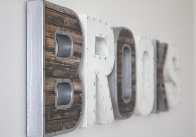 Custom wall letters for little boys room decor spelling out the name Brooks in rustic white and brown tones.