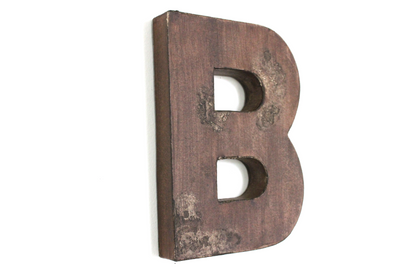 "Brown ""wooden"" distressed wall letter B."