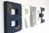 Vintage airplane nursery letters spelling out Bryce in navy, white, and silver.