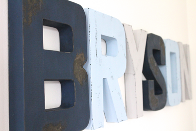 Nautical nursery letters spelling out Bryson in navy, blues, and grey.