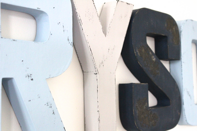 Custom wall letters for nautical nursery decor.