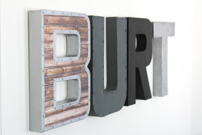 Modern farmhouse nursery boy name wall letters spelling out the name BURT.