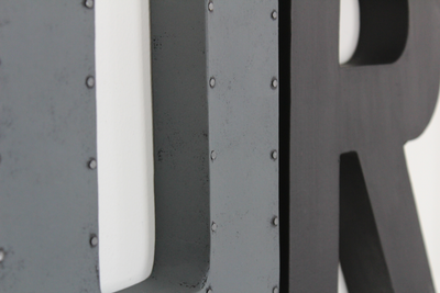 "Rustic ""metal"" gray letter U and black modern letter R."
