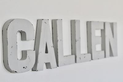 Light grey custom wall letters spelling out Callen.