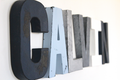 Nautical blue and silver nursery letters spelling out the name Calvin.