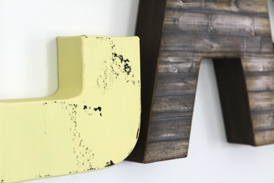 Yellow distressed farmhouse letters.